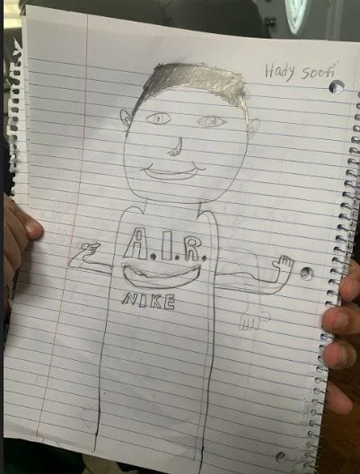 pencil drawing of a person wearing a nike shirt with his arms up
