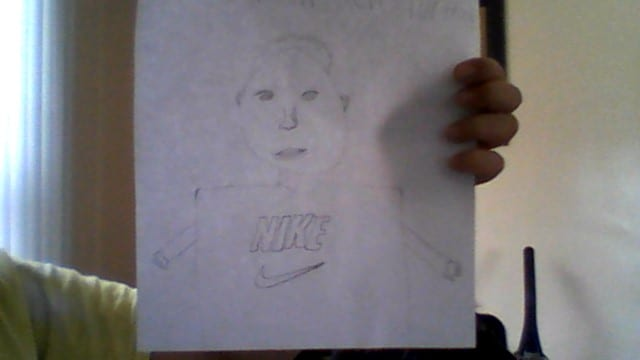 pencil drawing of a person with a nie shirt on