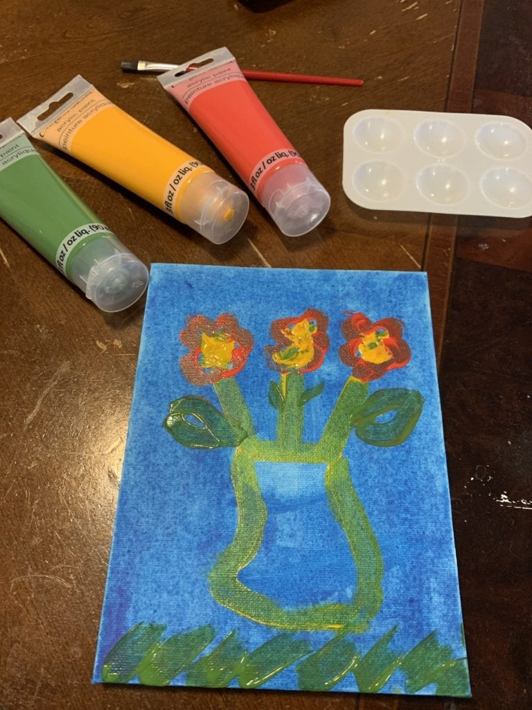 painting of three flowers in a vase with a blue sky