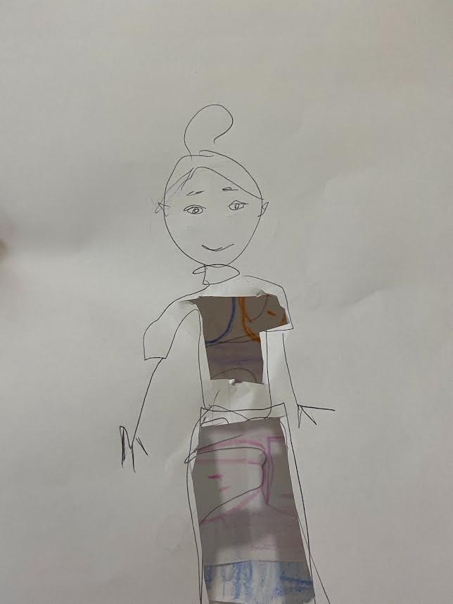 drawing of a person on paper with a cut-out where her clothes should be so the background pattern appears to be on her shirt and pants