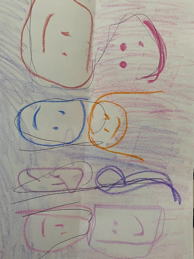 drawing of several smiling faces