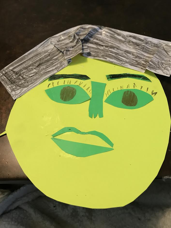 yellow face with green facial features