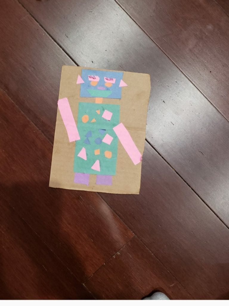 robot made from cut shapes from colored paper