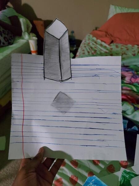 a drawing of a rectangular prism with a shadow under it