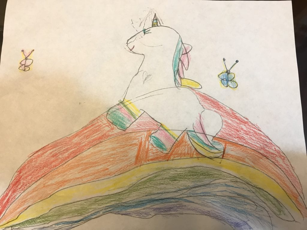 drawing of a unicorn walking over a rainbow