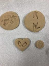 salt dough circles with designs pressed into them