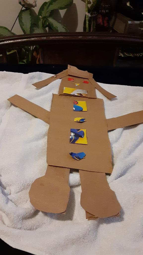 robot made from shapes cut out of cardboard
