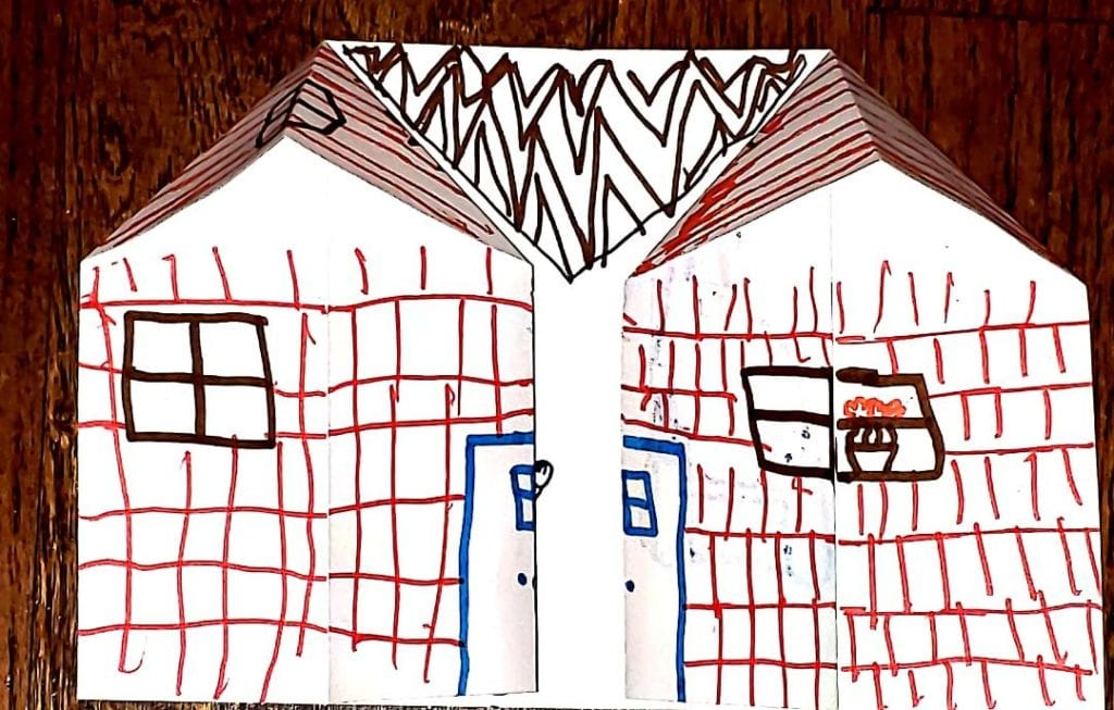 origami house with red bricks drawn with marker