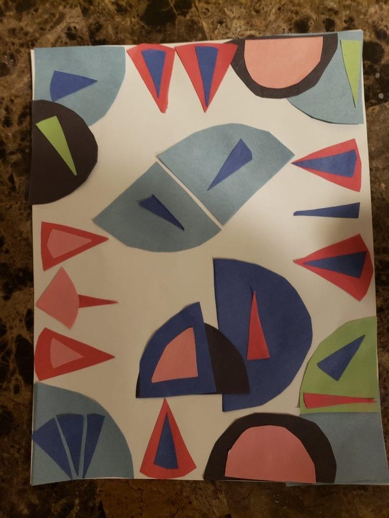 circles, semi circles, and quarter circles glued in a design on a paper