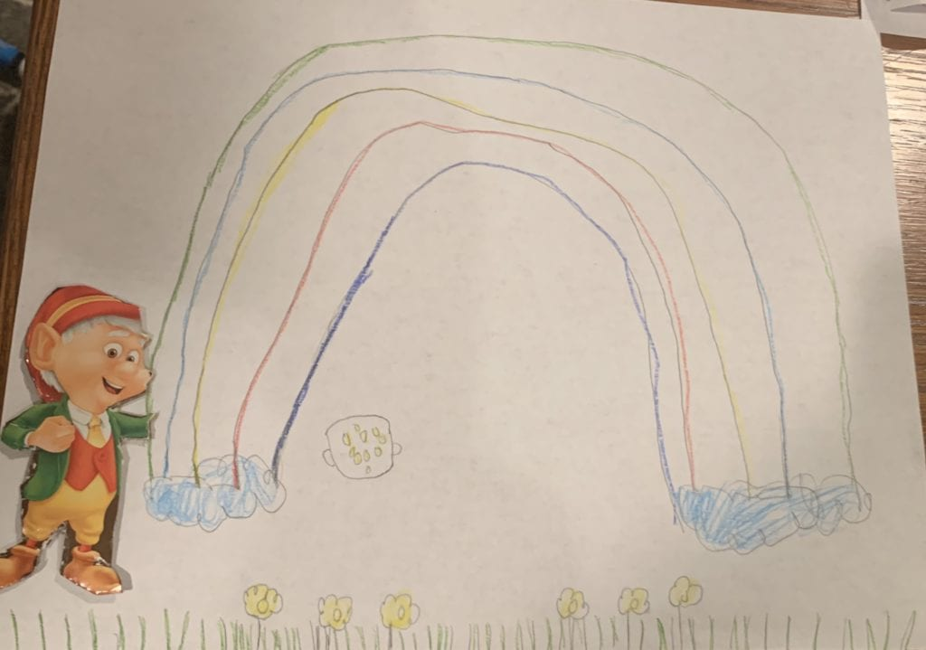 drawing of a rainbow with a picture of the Keebler Elf glued next to it