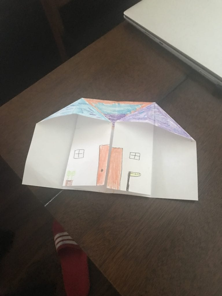 origami house with a red door