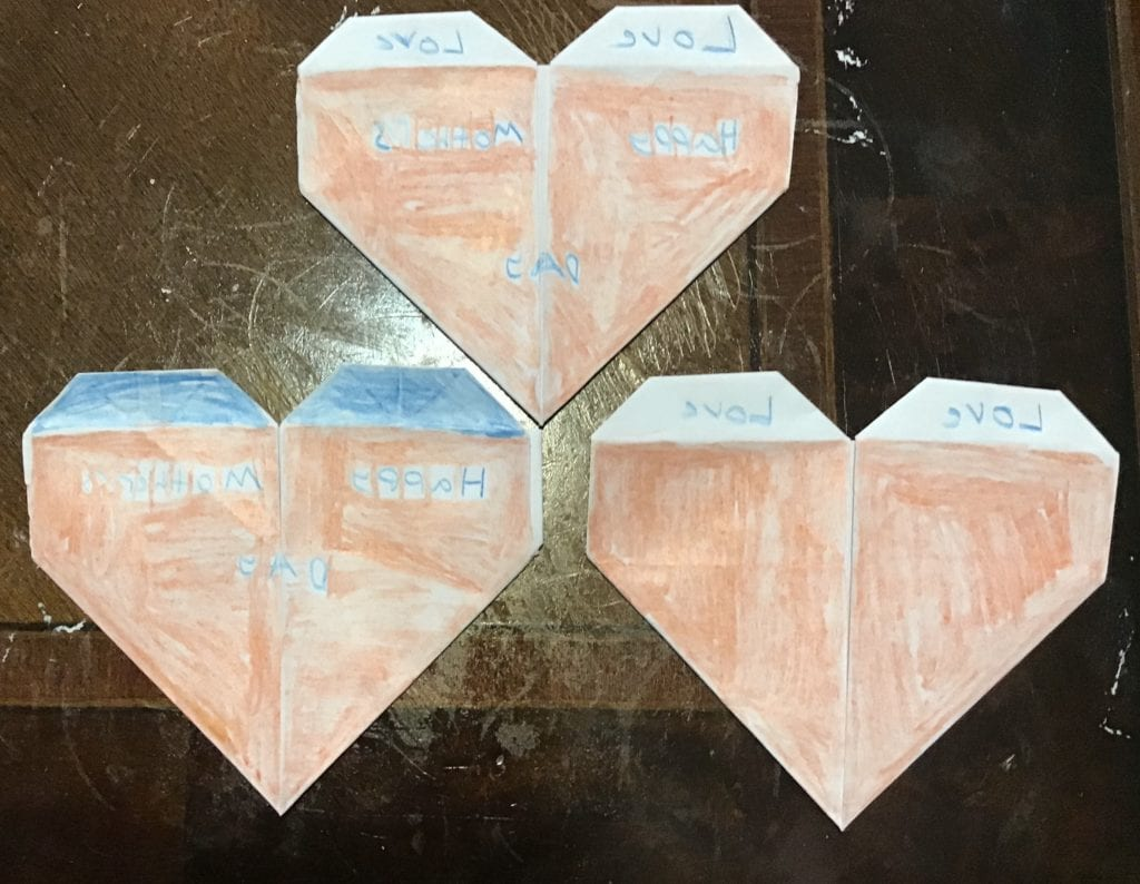 three origami hearts that say love and Happy Mother's Day