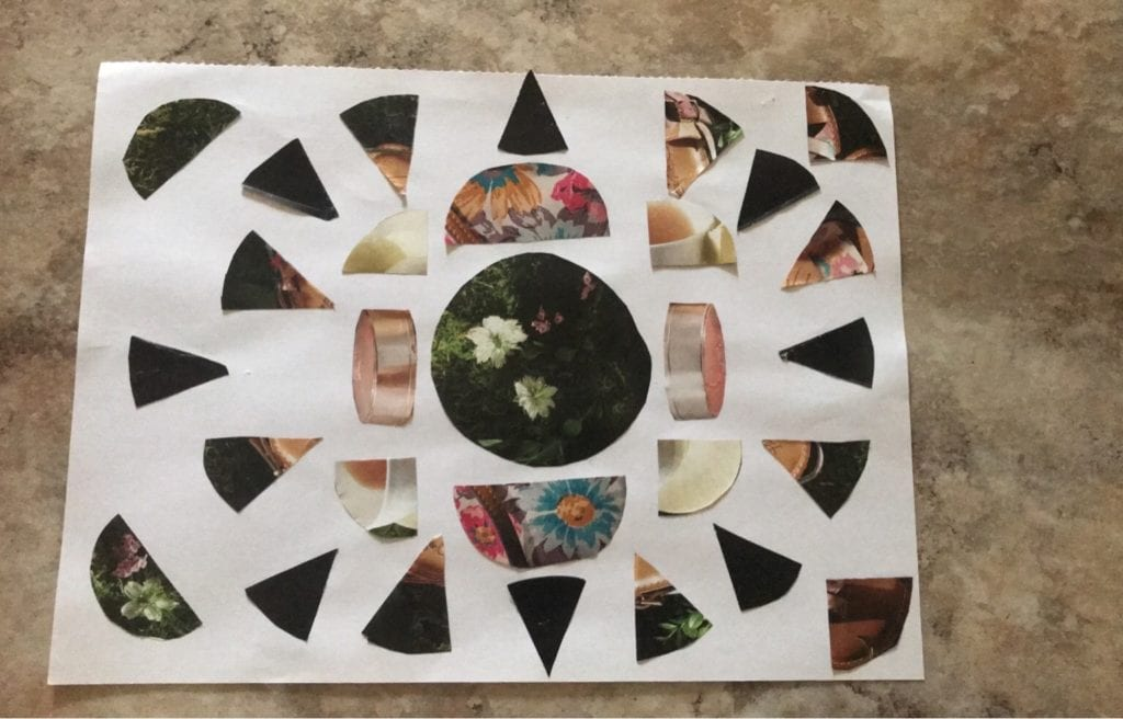 magazine collage that shows a circle and pieces of a circle cut from a magazine