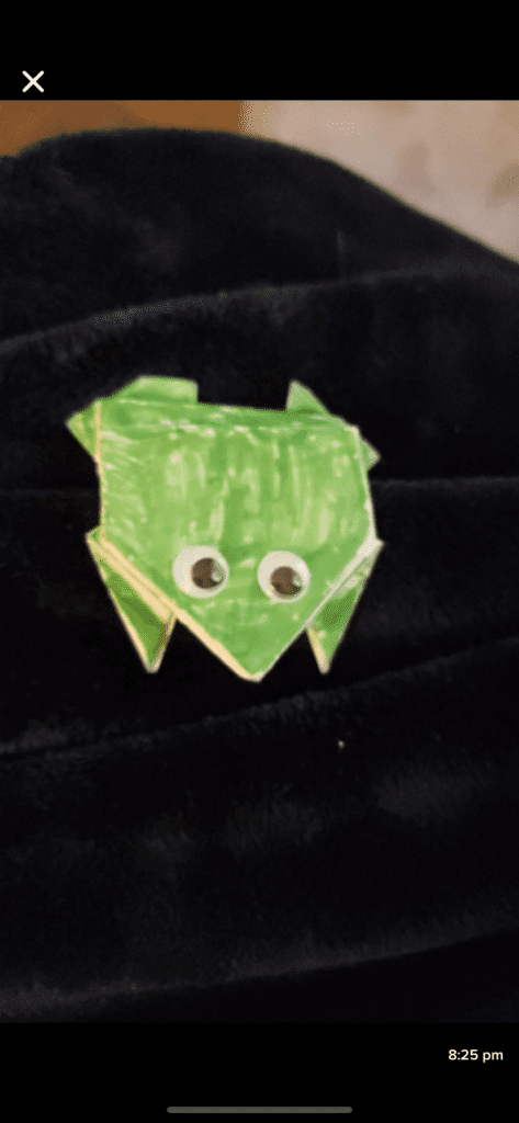 green origami frog with google eyes