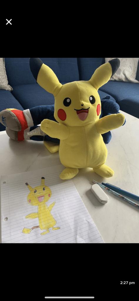pikachu stuffed animal next to a drawing of pikachu