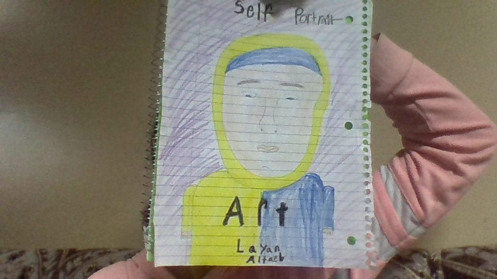 self portrait drawing of a girl wearing a yellow hijab