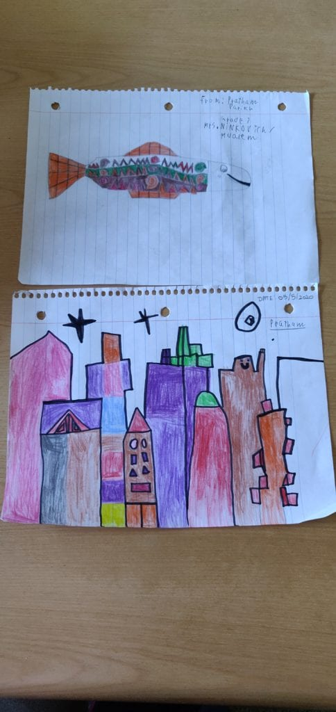 drawing of a fish and a seperate drawing of a colorful city