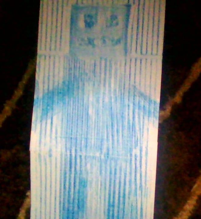 blue crayon rubbing of a robot