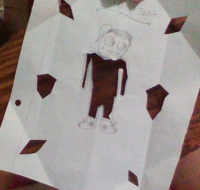 drawing of a girl with her clothes cut out and other parts of the paper cut out too