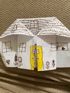 origami house with a yellow door