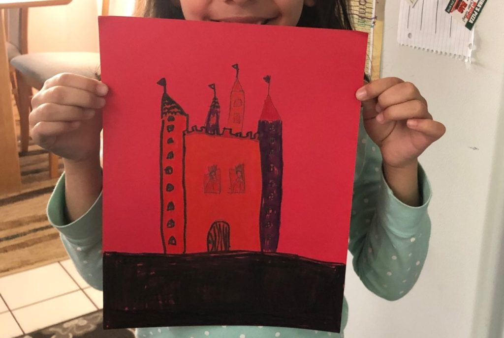 drawing of a castle that is colored different colors on red paper