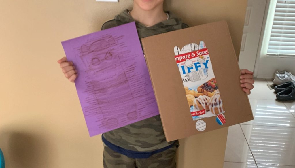 robot made out of a jiffy box and a purple copy of the robot made with a crayon rubbing