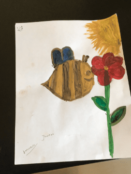 painting of a bee smelling a flower and a sun in the sky