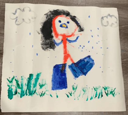 drawing of a person with black hair and two large blue feet