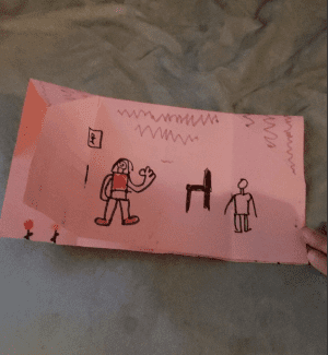 inside of a pink origami house- a drawing of two people and a chair