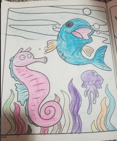coloring book page of a fish and sea creatures colored in