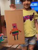 robot made out of cardboard and colored like a rainbow