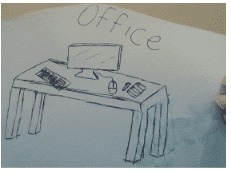 """a table with a computer, keyboard, and pens on it that says """"office"""""""