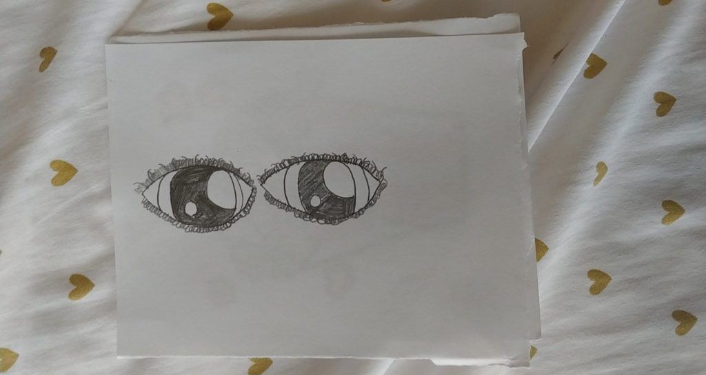 pencil drawing of two eyes