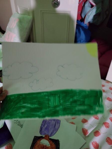 drawing of a landscape with green grass, clouds, and a sun