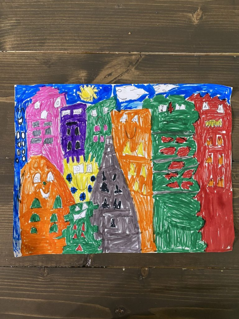 drawing of a city with buildings that all have different colors, designs, and faces
