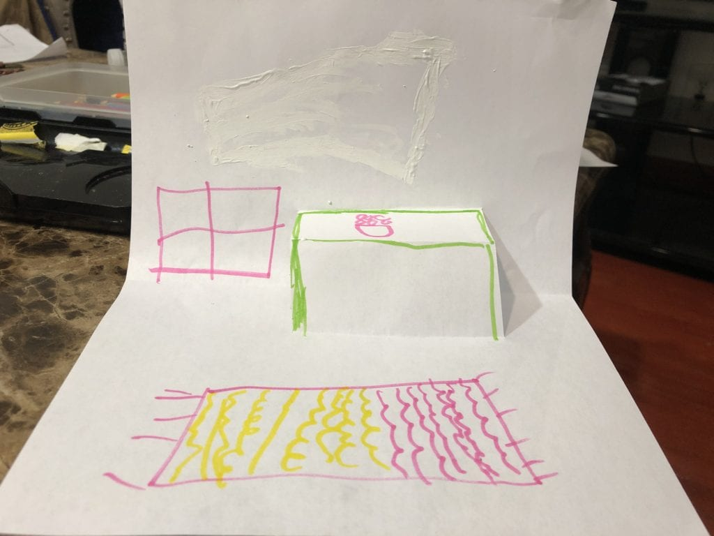 pop up table with a drawing of a rug and window on paper