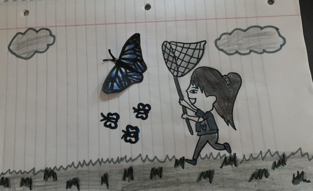 picture of a butterfly cut out and glued to a pencil drawing of a girl chasing the butterfly