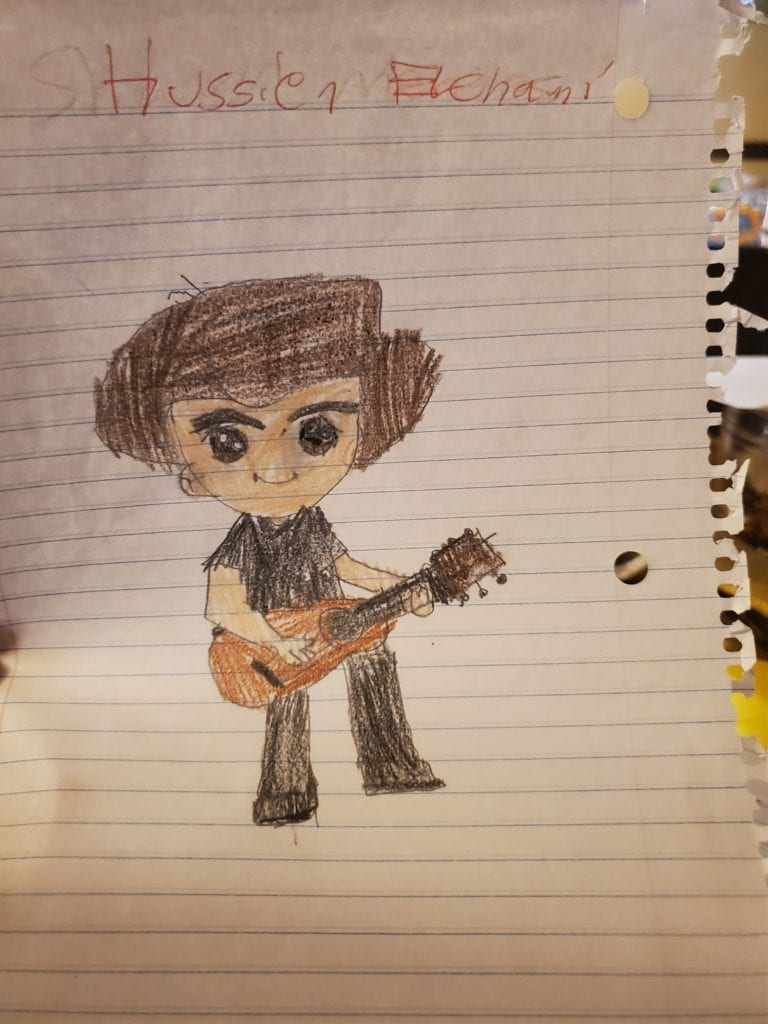 drawing of a person with brown hair playing a guitar