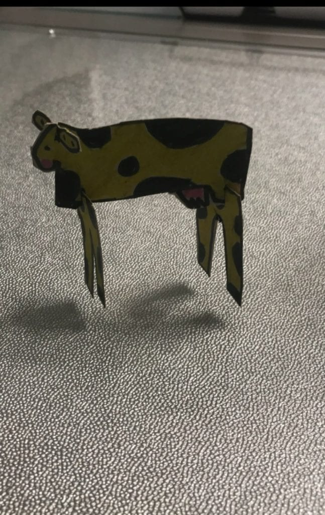 cow made from cardboard that stand up