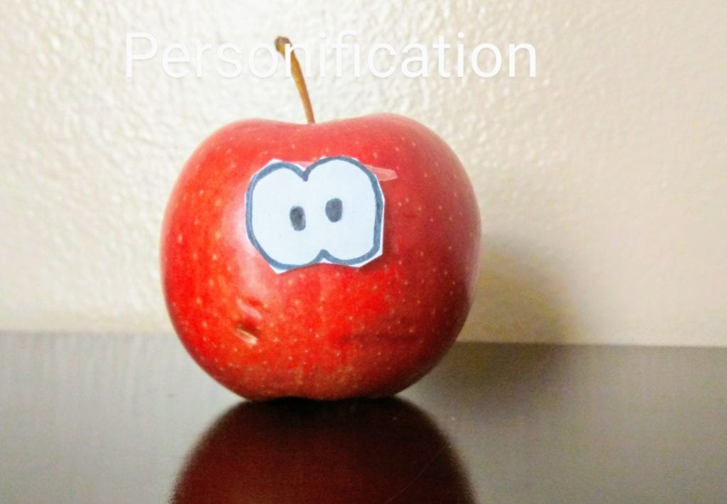 apple with eyes taped to it