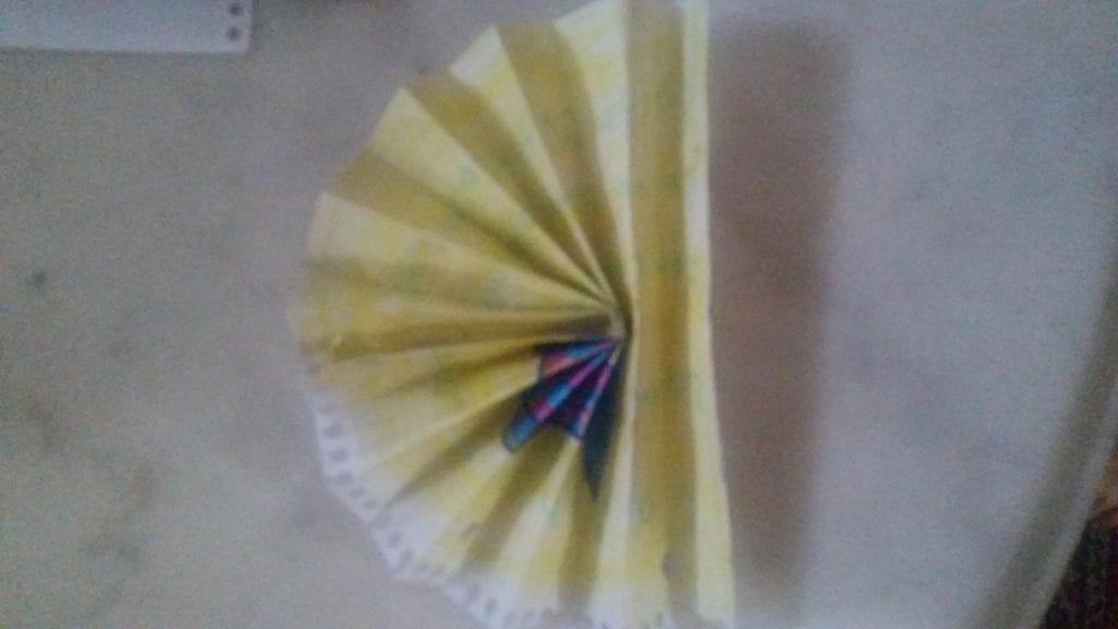 yellow paper folded fan