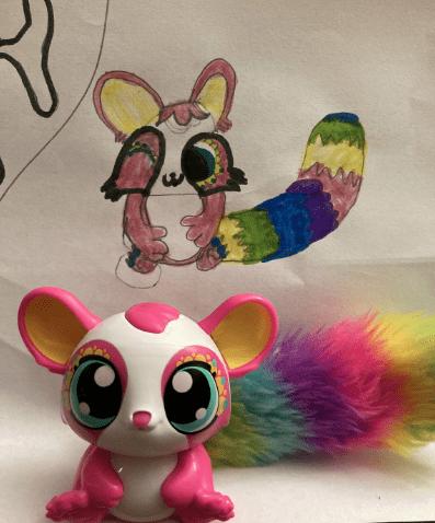 drawing of a stuffed animal next to the stuffed animal