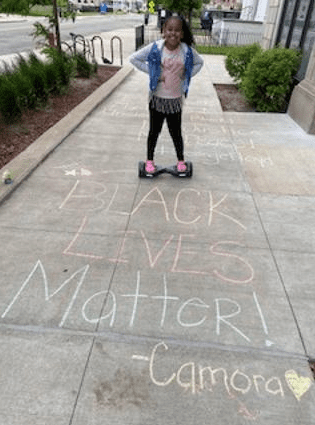 chalk drawing that says black lives matter- camora