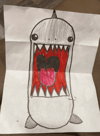 drawing of a shark with its mouth open