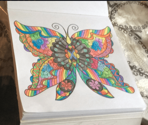 butterfly coloring page colored with rainbows