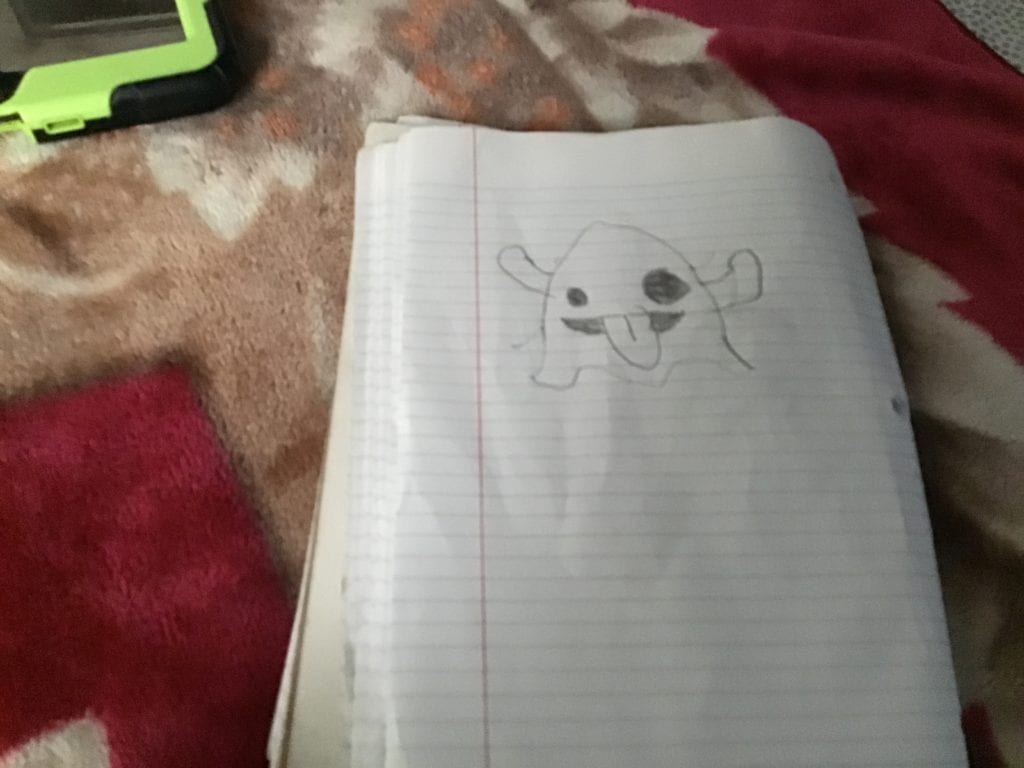 drawin gof a ghost sticking its tongue out