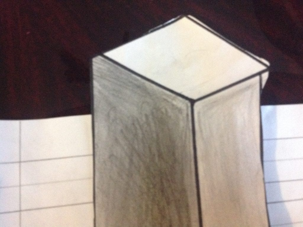 drawing of a 3d rectangular prism with shading on two sides