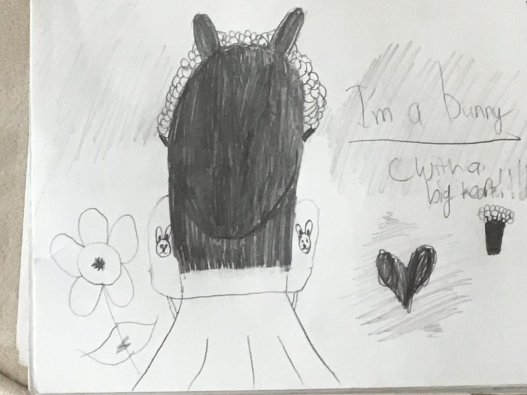 drawing of the back of a girl's head wearing bunny ears