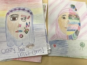 student made self-portrait drawings that have one half of their face that looks like them and the other half has drawings of things they like (a panda bear, a rainbow, a donut, etc.)