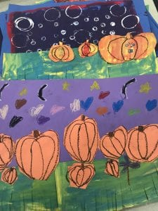 two student collages that show pumpkins sitting in the grass with a purple sky with stars